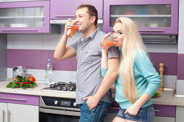 Portrait of a cute young couple drinking fresh citrus juice