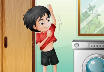 A young boy changing his shirt
