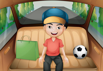 A boy sitting inside a running car