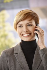 Young businesswoman talking on mobile