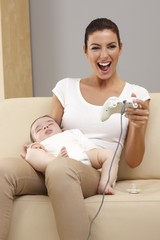 Young mother playing video game