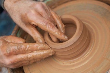 craftsman works in clay pot