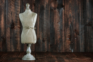 Antique Mannequin Busts on Wood Grunge Background
