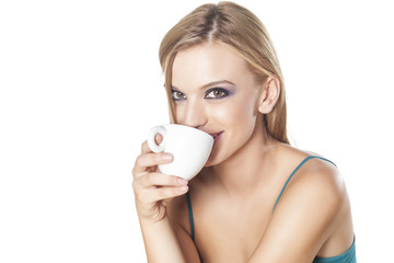 portrait of a smiling beautiful girl drink her cup of coffee