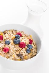Bowl of muesli with fresh berries an milk