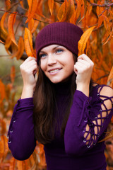 Beautiful woman in autumn garden