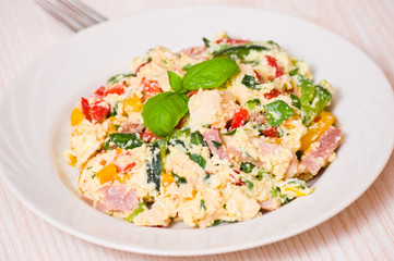 salad with chicken breast, ham, cheese, egg and vegetables