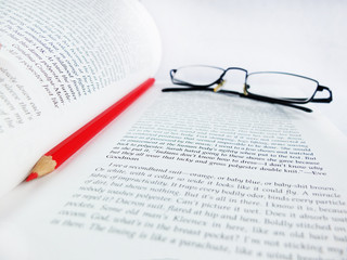 Glasses, Red Pencil and Open Book