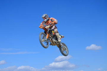 bike jumping on blue sky