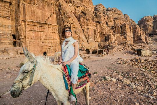 tourist riding donkey  in nabatean city of  petra jordan