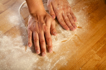 Making pastry dough for cake. Series. A baker kneading dough.