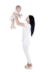 Portrait of joyful mother and her baby having fun - isolated