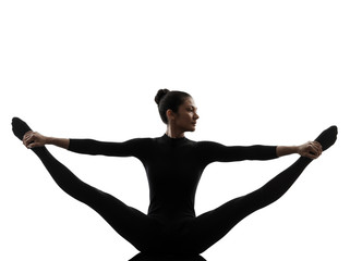 Wall Mural - woman exercising gymnastic yoga  stretching split  silhouette