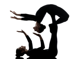 Wall Mural - two women contortionist  exercising gymnastic yoga silhouette