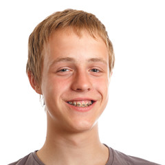 smiling teenager with dental braces