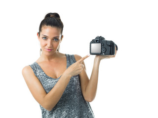 woman with camera could be a tourist or a proffesional