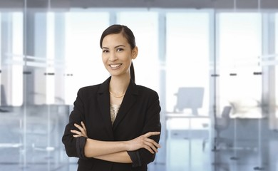 Happy asian businesswoman at office