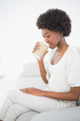 Thoughtful gorgeous brunette drinking coffee