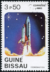 stamp shows the Space Shuttle spaceship blasting off