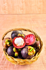 Fresh fruit in a basket on a wooden floor