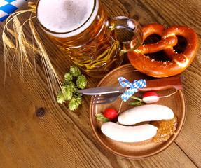 Oktoberfest menu with beer, white sausage, pretzel and radish