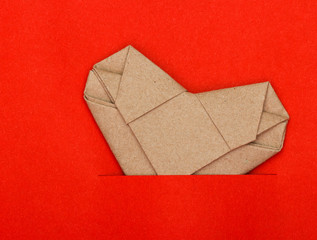 Origami recycle paper heart on red paper