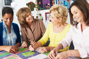 Group Of Women Making Quilt Together Fototapete