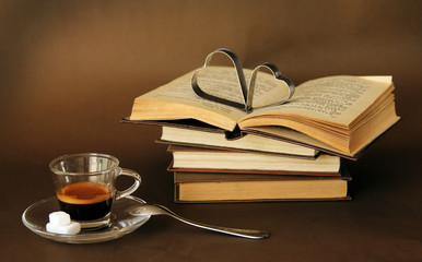 cup of coffee next to vintage books