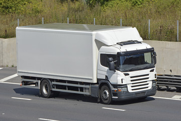 Rigid body white unmarked lorry on motorway