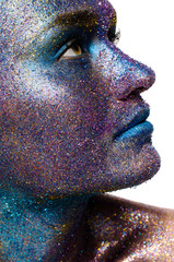 Beautiful face of a woman covered in glitter