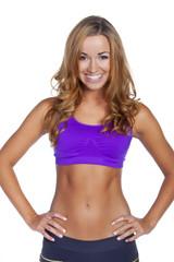Uśmiechnięta kobieta, Pani trener po ćwiczeniach fitness.