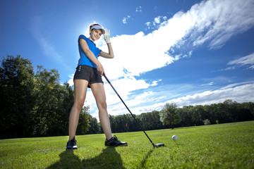 Woman playing golf on field