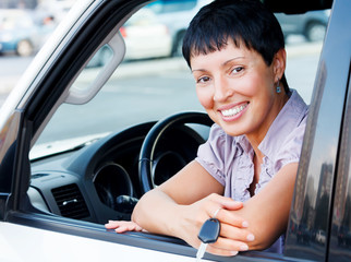 Senior woman holding car key