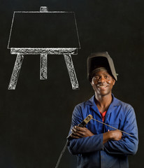 African industrial worker with easel on blackboard background