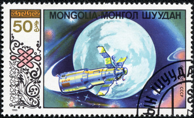 stamp printed in Mongolia shows spacecraft Salut