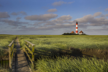 Foto op Canvas Vuurtoren Lighthouse and Bridge