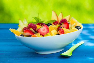 Mix of pieces of fresh delicious fruits in a bowl