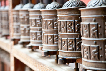 Wall Murals Nepal Prayer wheels in Rudra Varna Mahavihar temple in Patan. Nepal.