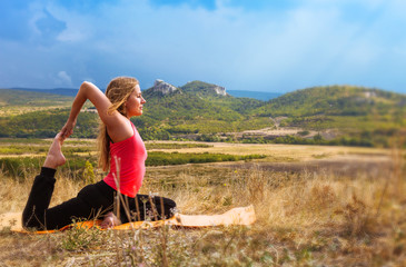 Young woman has outdoor yoga practice