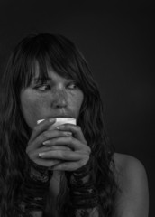 beautiful young woman holding cup of coffee