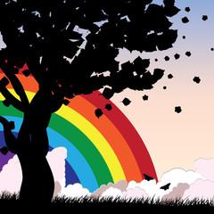Tree silhouette and rainbow