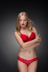 Fashion shoot of young blonde girl in lingerie