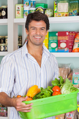 Man With Vegetable Basket In Grocery Store
