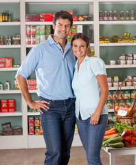 Couple Standing Against Shelves In Store