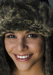 Happy smiling beautiful woman in fur hat