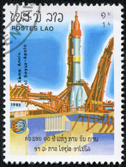 stamp printed in Laos shows Soviet rocket on launch pad