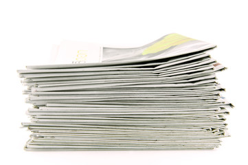 pile of newspapers isolated on white background