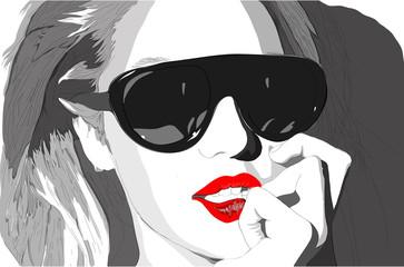 Woman in black glasses posing at camera