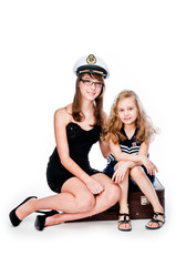 Two beautiful girls with suitcase