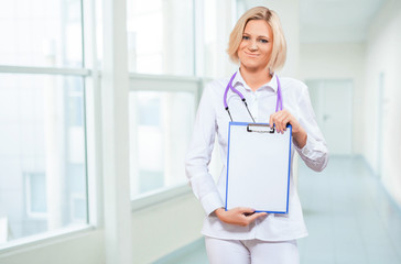 female doctor holding empty clipboard